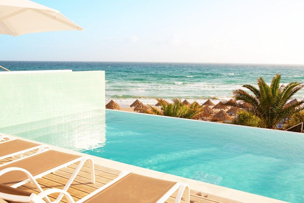 2-rums Club House Suite med havsutsikt och privat, delad pool som delas med 1-3 andra suiter.