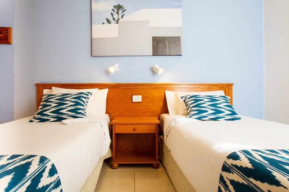 Sovrum i Tvårumslägenhet och Tvårumslägenhet på översta våningen