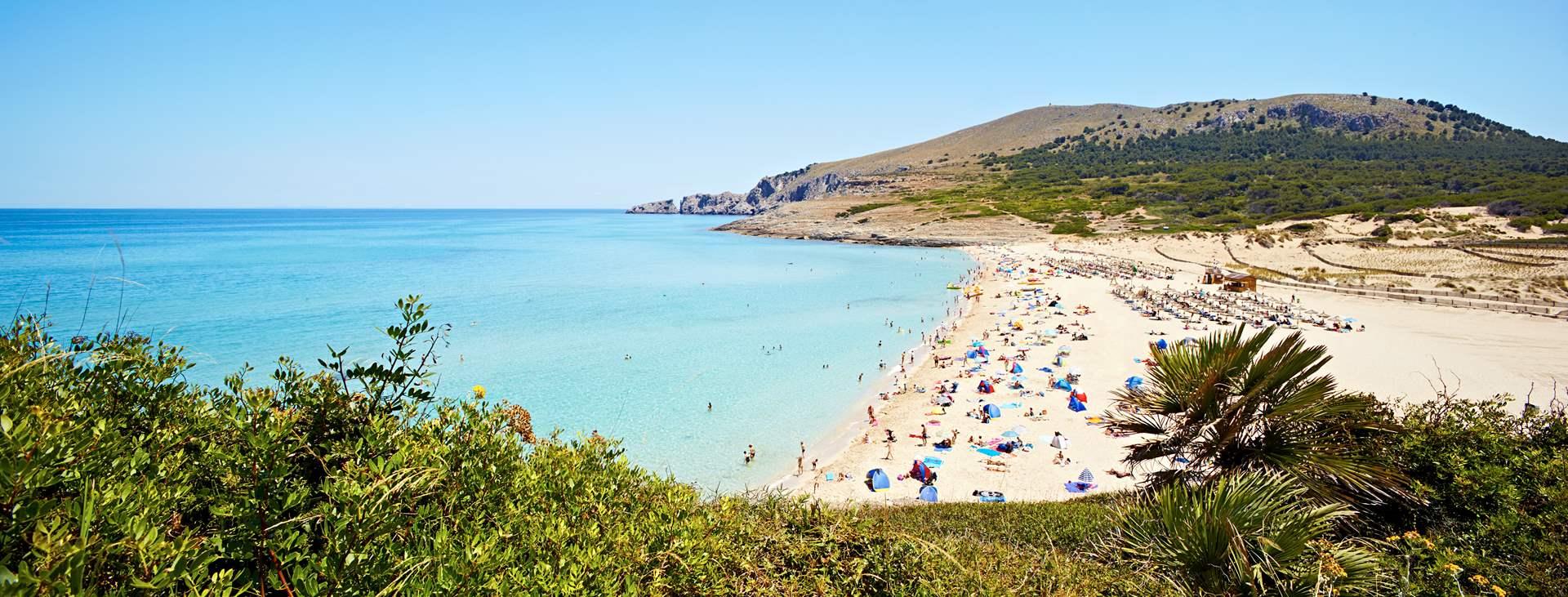 Boka en resa till barnvänliga Cala Mesquida på Mallorca